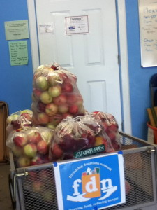 The weekly donations of apples from Cornell Orchards are stored in FDN's CoolBot.